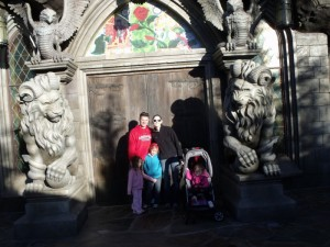 The family in front of Be Our Guest. It was December and cold!