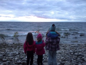 The girls checking out the water view near our campsite. Notice the winter coats and hats!